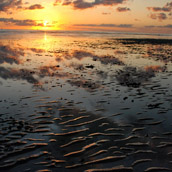 Sunrise over the Delaware Bay at Slaughter Beach, Delaware.  Landscape Photograpy by Alex Wilson.