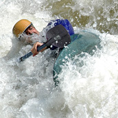 A kayaker navigates a class 4 rapid at pillow rocks on the Gauley River during Gauley Fest near Summersville, WV.  Event Photography by Alex Wilson